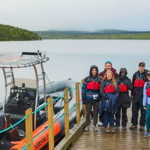 A group of people getting to take a zodiac boat tour in Gros Morne National Park, Newfoundland
