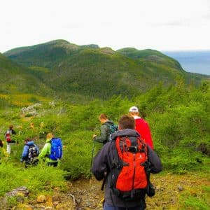 A group of people on a guided Hike on the the Green Gardens trail in Gros morne